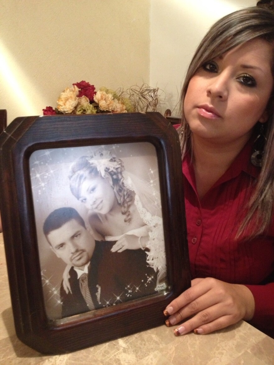 Janet Olazaran Banderas says her husband, seen with her in the photograph, was picked up by transit police two years ago for parking on the wrong side of the street. She never saw him again.
