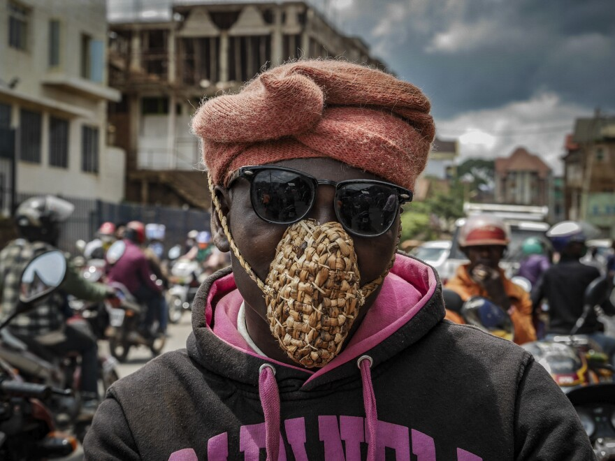 A man wears a mask made from dried banana leaf in the eastern Congolese city of Bukavu. The unusual choice of material is likely meant as a protest against the government requirement of mask-wearing in public, with a stiff fine for violators.