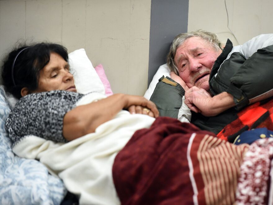 Evacuees Steve Allen and Alicia Castro lie on cots at the Placer County Fairgrounds evacuation center in Roseville, Calif. They are two of the almost 200,000 people under evacuation orders in Northern California Monday after a threat of catastrophic failure at part of the Oroville Dam.