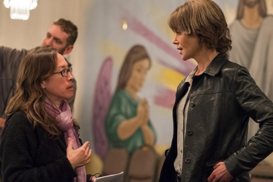 Director Karyn Kusama instructs Nicole Kidman on the set of <em>Destroyer.</em>