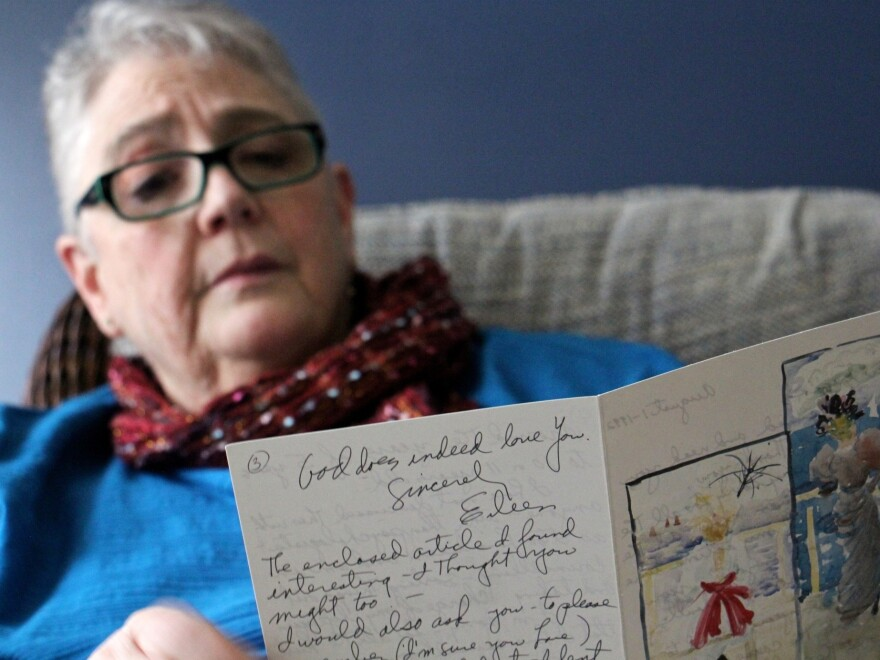 Patricia Cahill reads a card sent to her in 1992 by the nun who sexually abused her for years.