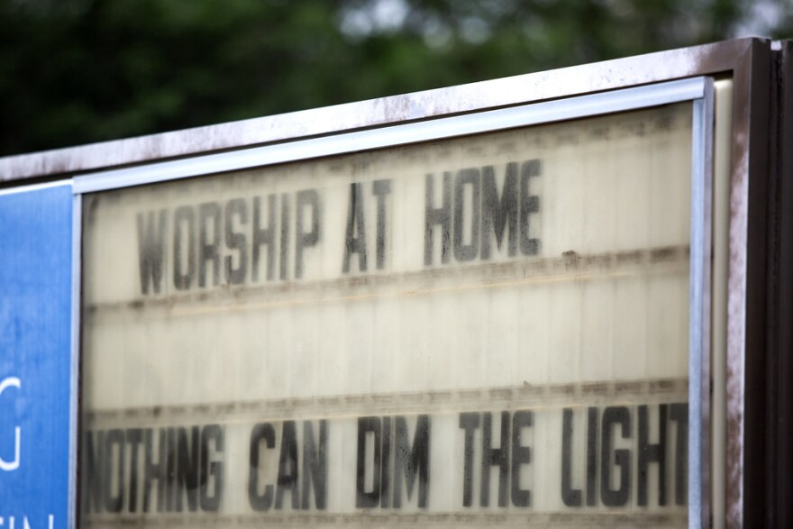 A sign outside a Quaker church on Martin Luther King Boulevard tells people to worship at home.