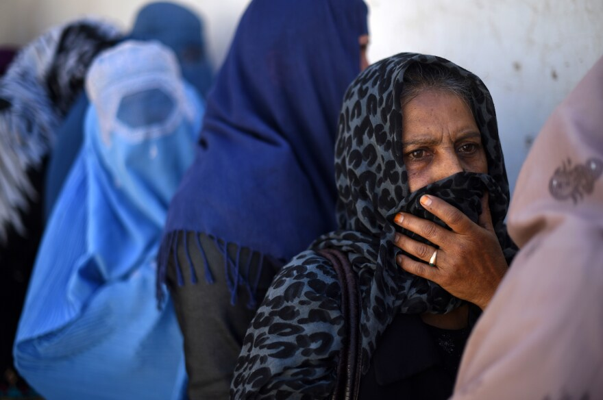 Afghan women line up to receive a donation of food during the month of Ramadan in Kabul on July 9, 2015. The Afghanistan's Chamber of Commerce and Industries distributed food to some 1,000 families.