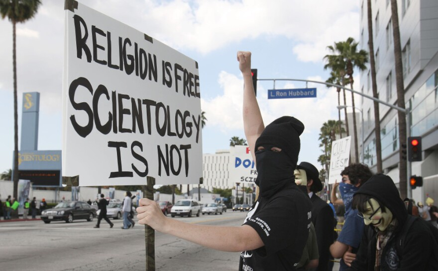 """Disguised members of the """"hacktivist"""" group called Anonymous took to the streets of Los Angeles in March 2008 to protest near buildings associated with the Church of Scientology. Similar demonstrations were held in cities mainly in the U.S. and Europe."""