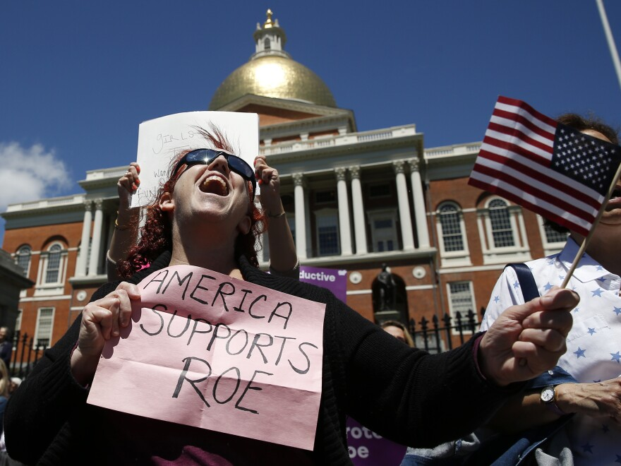 Women's rights activists, including Jane Marcus of Medford, pictured in May, have been urging the legislature to pass a law that codifies abortion rights in state law.