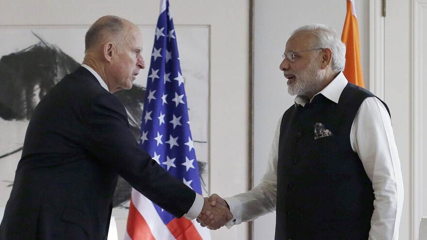 Gov. Jerry Brown (left) meets with Prime Minister of India Narendra Modi in San Jose, Calif., on Sept. 27. Brown has been brokering his own international agreement on climate change.