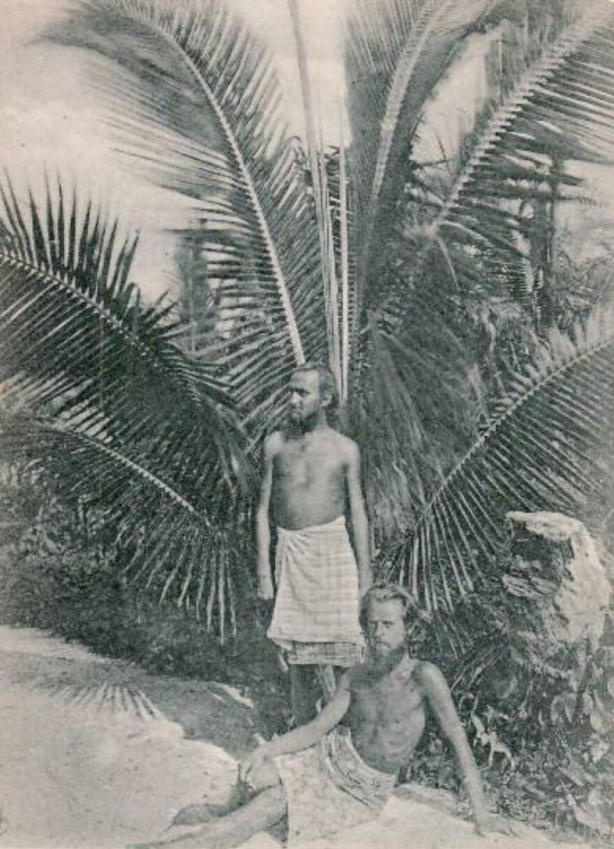 August Engelhardt stands underneath a palm tree with Berlin concert pianist Max Lützow at his feet. Lützow went to Kabakon to join Engelhardt's sun-worshipping cocovore cult, The Order of the Sun. He died there, as did several other followers.