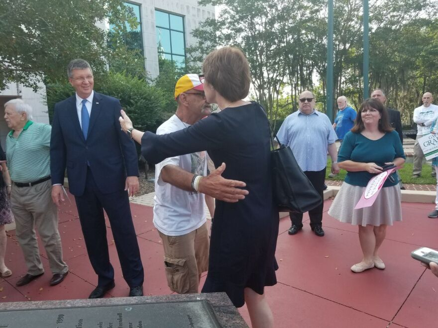 Graham greets supporters with hugs outside the Leon County Courthouse. She cast her ballot Thursday (8/23/18) before heading off for the rest of her campaign swing.