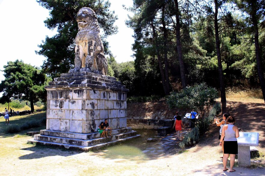 Tourists visit the Lion of Amphipolis on Aug. 18. The large tomb, its occupant unknown, was found nearby. But Greek authorities have not yet allowed the public to visit the site of the tomb.