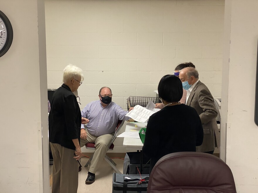 Union County Board of Elections Members observe as staff enter the final ballots into the tabulator after voting to approve them. November 13, 2020
