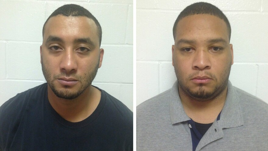 City Marshals Norris Greenhouse (left) and Derrick Stafford are seen in their booking photos provided by Louisiana State Police in New Orleans. They were arrested Friday on charges of killing a 6-year-old boy and critically wounding his father during a car chase.