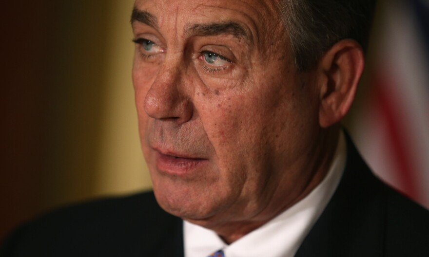 Speaker of the House John Boehner talks with reporters in his office in the U.S. Capitol on Friday.