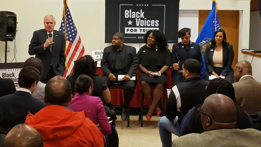 Sen. Ron Johnson (R-Wisc.) speaks at the Milwaukee Black Voices for Trump event, as Jerome Smith, Cecilia Johnson, Angela Stanton-King and Corrin Rankin wait to address the meeting.