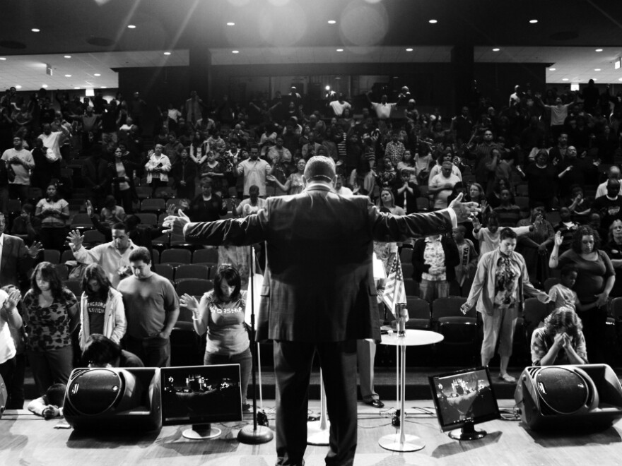 <p>The Rev. Wilfredo de Jesus delivers a sermon at the New Life Covenant Church in Chicago. The church has grown from a congregation of dozens to thousands of families in just a few years.</p>