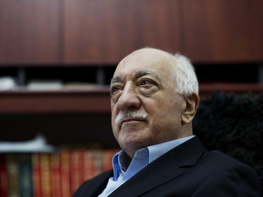 Turkey's government accuses U.S.-based cleric Fethullah Gulen, pictured in 2014, of inciting the failed coup, which has set off a round of dismissals and detainments.