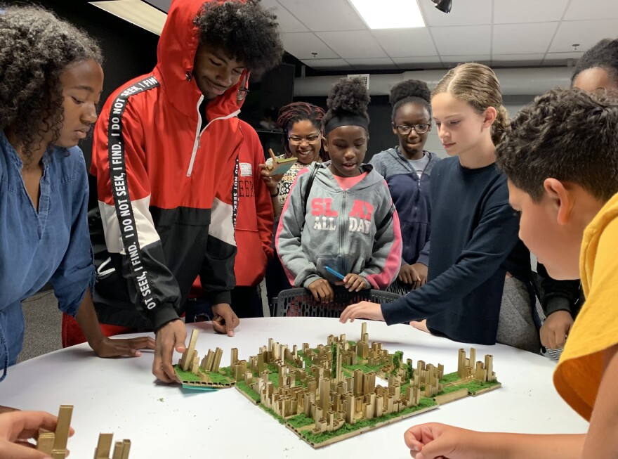 Children design a miniature city, inspired by their favorite hip-hop songs. KERRY SHERIDAN/WUSF