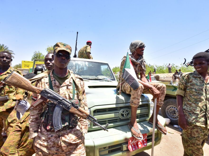 Sudanese armed forces gather near the site of a demonstration close to the military headquarters in Khartoum on Monday.