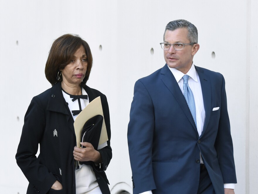 Former Baltimore Mayor Catherine Pugh and her attorney arrive for a sentencing hearing in Baltimore on Thursday. Pugh pleaded guilty to federal fraud, tax and conspiracy charges last year.