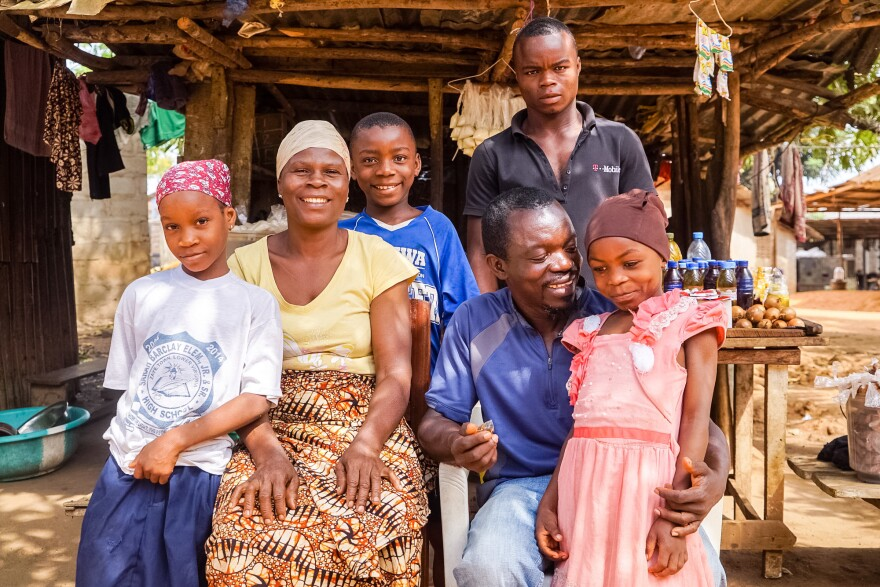 They're a family of survivors (from left): Ramatu Shellu, 8; Bindu Shellu, 44; Luqman Shellu, 10; Hassan Shellu, 22; Reuben Shellu, 43; and Kadija Shellu, 7, pose at their family home in Monrovia. Not pictured: Sekou Shellu, 24, who was working out of town when this picture was taken.