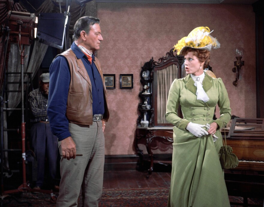 Maureen O'Hara acts opposite John Wayne during scene in the film <em>McLintock</em>! The pair starred in five films together during their careers.