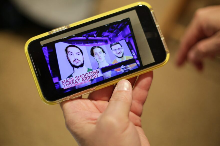 Lee Ann Potter shows a news video featuring Brandon Wagshol (left), which she recorded on her cell phone.
