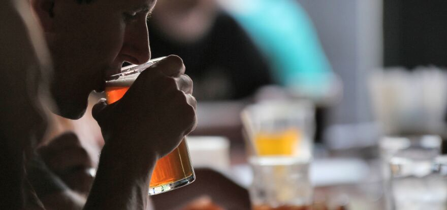 Image of man drinking a beer.