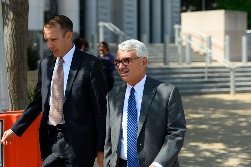 Assistant U.S. Attorney Hal Goldsmith, right, walks out of the Eagleton Courthouse on Friday, August 9, 2019, after Stenger was sentenced to 46 months in prison.