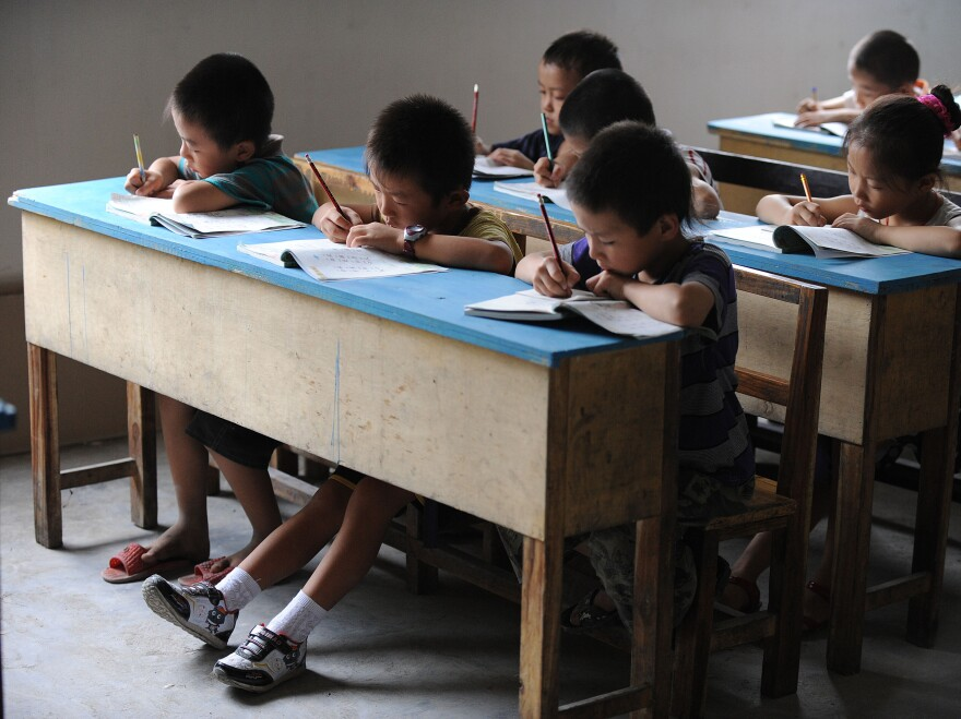 Chinese schoolchildren during lessons at a classroom in Hefei, east China's Anhui province, in 2010.