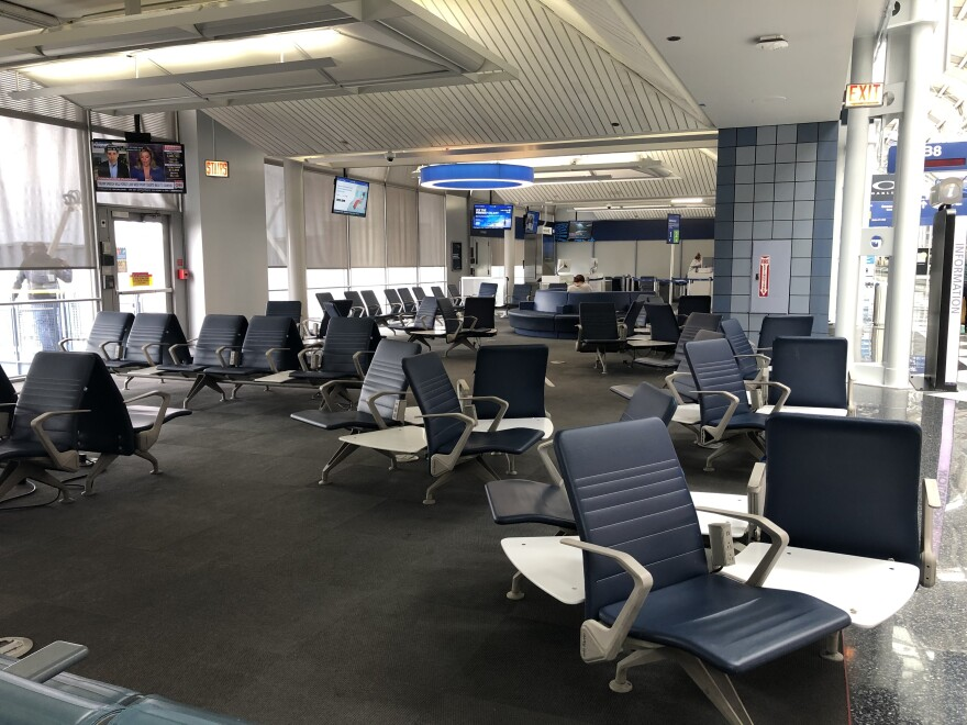 At O'Hare airport, normally packed gate areas have scores of empty seats.