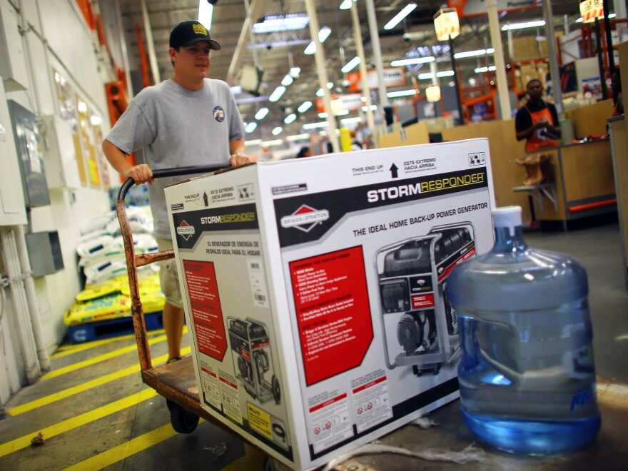 Home Depot has long offered credit cards, partly to serve customers who have just suffered major house damage. The company has recently widened those efforts. Here, a Tampa, Fla., customer buys a generator and bottled water, preparing for Tropical Storm Isaac's arrival in August.