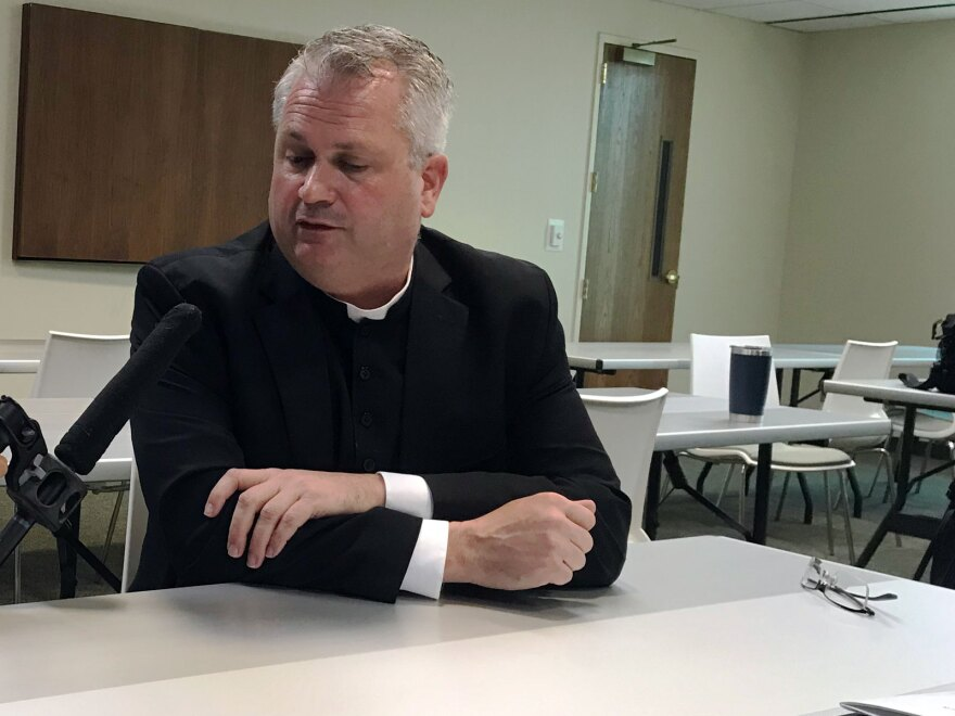 Father Patrick Winslow, the vicar general and chancellor of the Diocese of Charlotte.