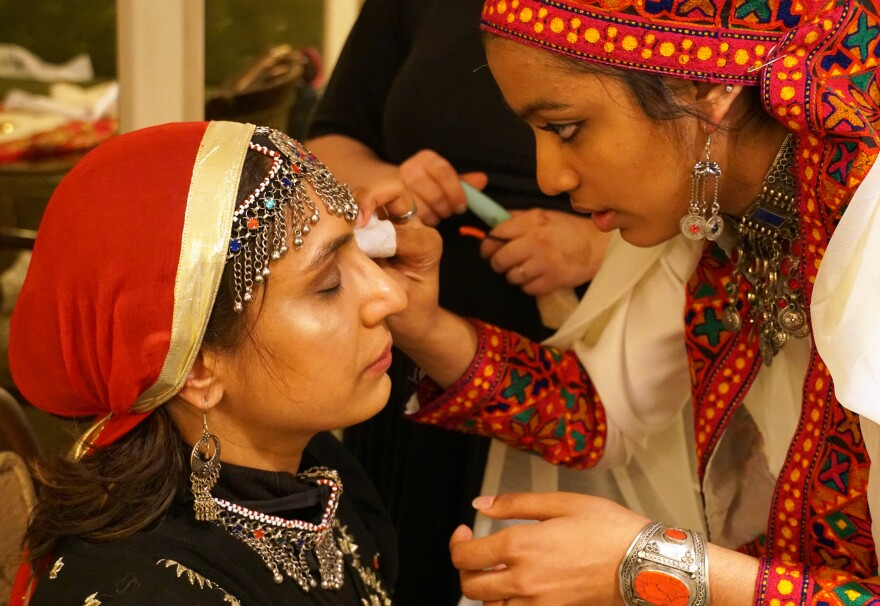 Faheema Hassan, left, prepares for the Modest Muslim Women's Fashion Show on April 20, 2019.