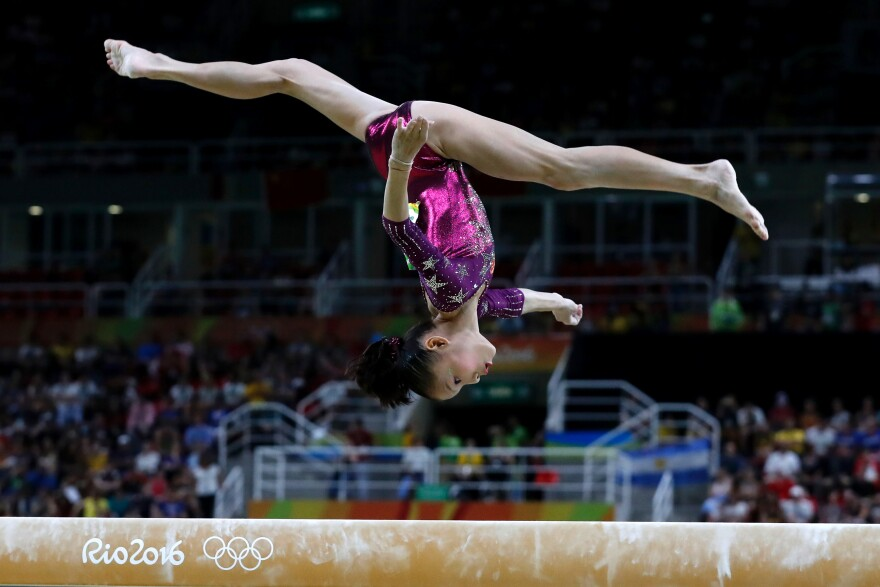 China's Shang Chunsong competes in the beam event during the women's team final.