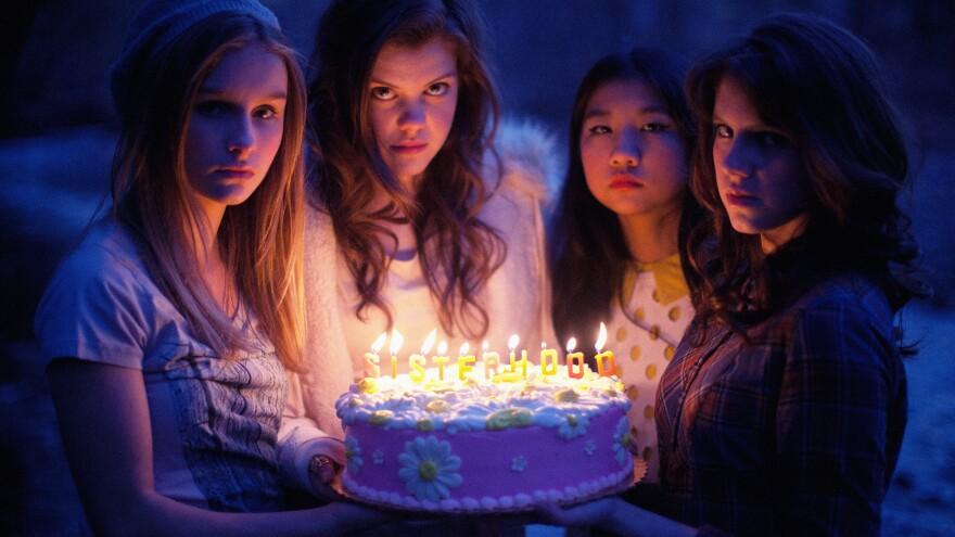 Olivia DeJonge, Georgie Henley, Willa Cuthrell, and Kara Hayward in <em>The Sisterhood Of Night</em>.