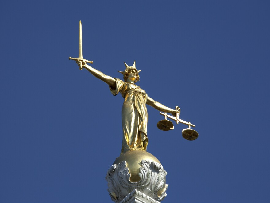 The statue of Justice atop the Old Bailey courthouse in London.