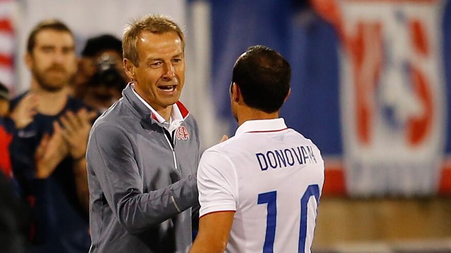Donovan shakes hands with Head Coach Jurgen Klinsmann as he leaves the field.