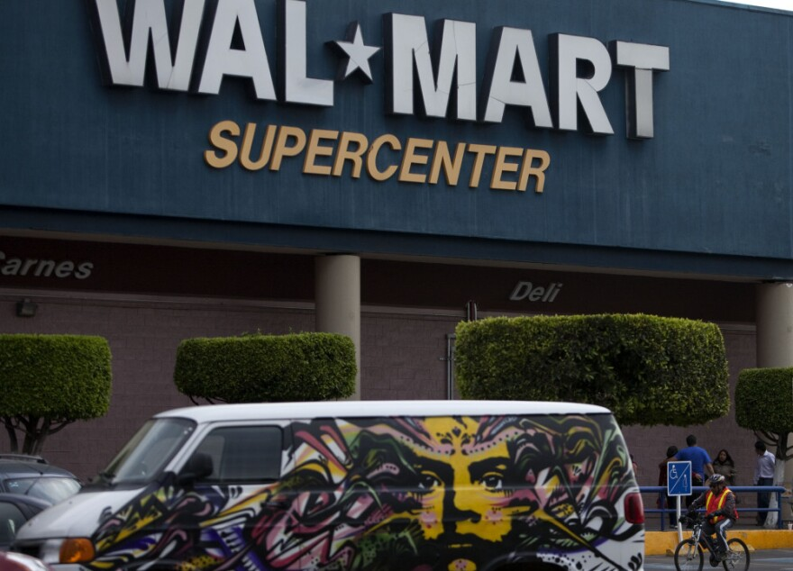 A van covered by a mural sits parked outside a Walt-Mart Super Center in Mexico City. Wal-Mart Stores Inc. hushed up a vast bribery campaign that top executives of its Mexican subsidiary carried out to build stores across Mexico, according to a published report by the <em>New York Times</em>.