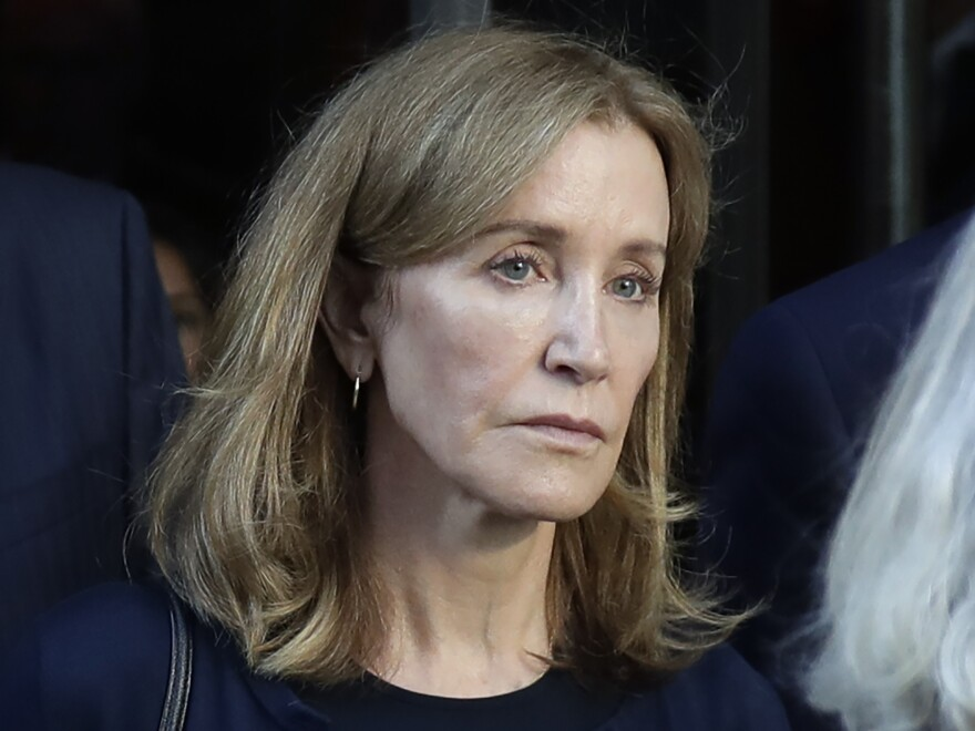 Actress Felicity Huffman leaves federal court after her sentencing in a nationwide college admissions bribery scandal in Boston last month.