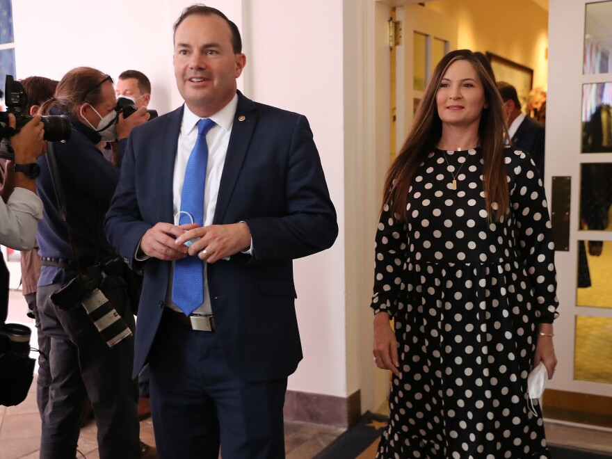 Sen. Mike Lee (R-Utah) and his wife Sharon Lee walk into the Rose Garden for President Trump's Supreme Court announcement.