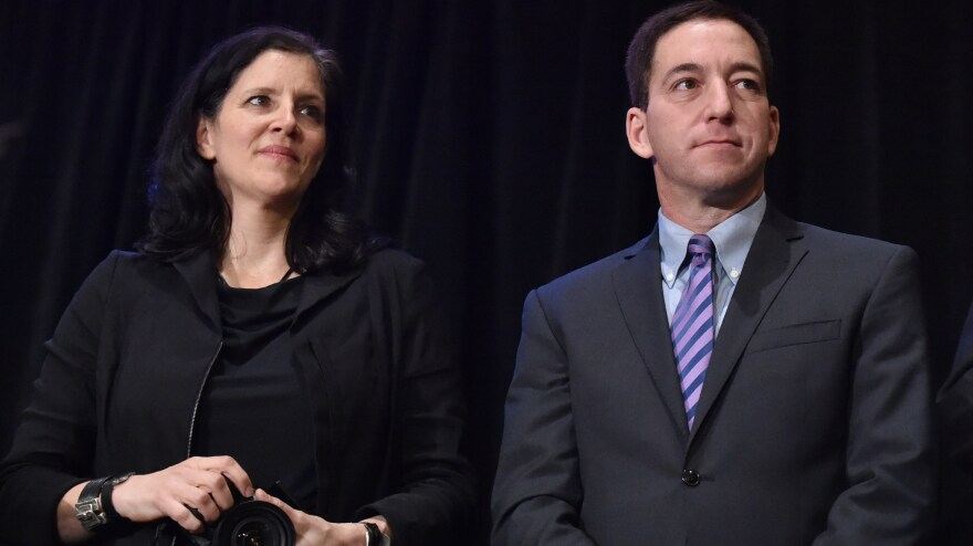 Journalists Laura Poitras and Glenn Greenwald helped <em>The Guardian</em> win a Pulitzer Prize for public service along with <em>The Washington Post</em> Monday, for their stories based on NSA documents provided by Edward Snowden.