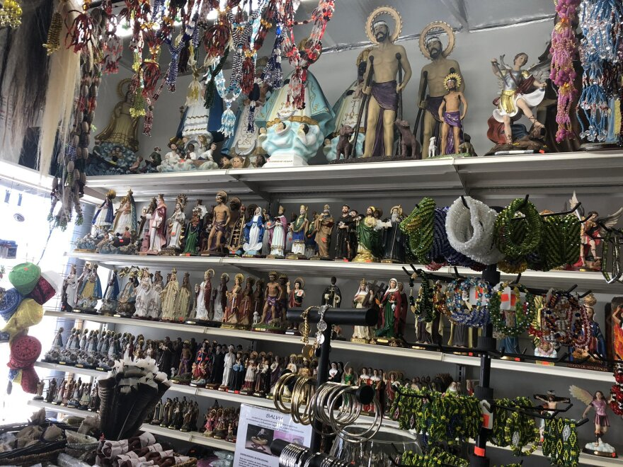 The interior of Botánica Nena, featuring an array of figures and statues of saints who are part of Afro-Caribbean traditions.