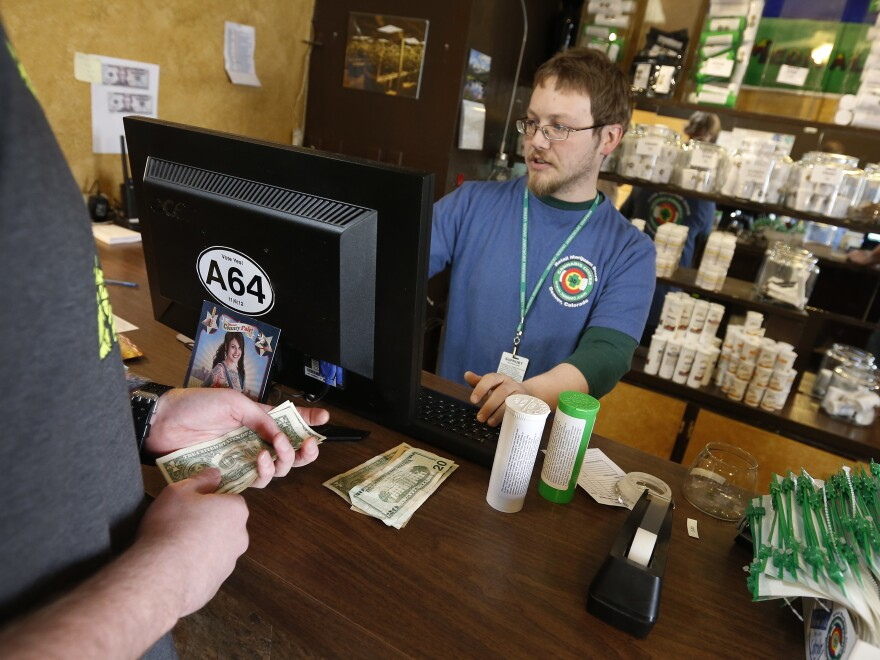 A bipartisan group of attorneys general is urging Congress to pass legislation that would make it easier for banks to handle money involved in the legal cannabis industry.