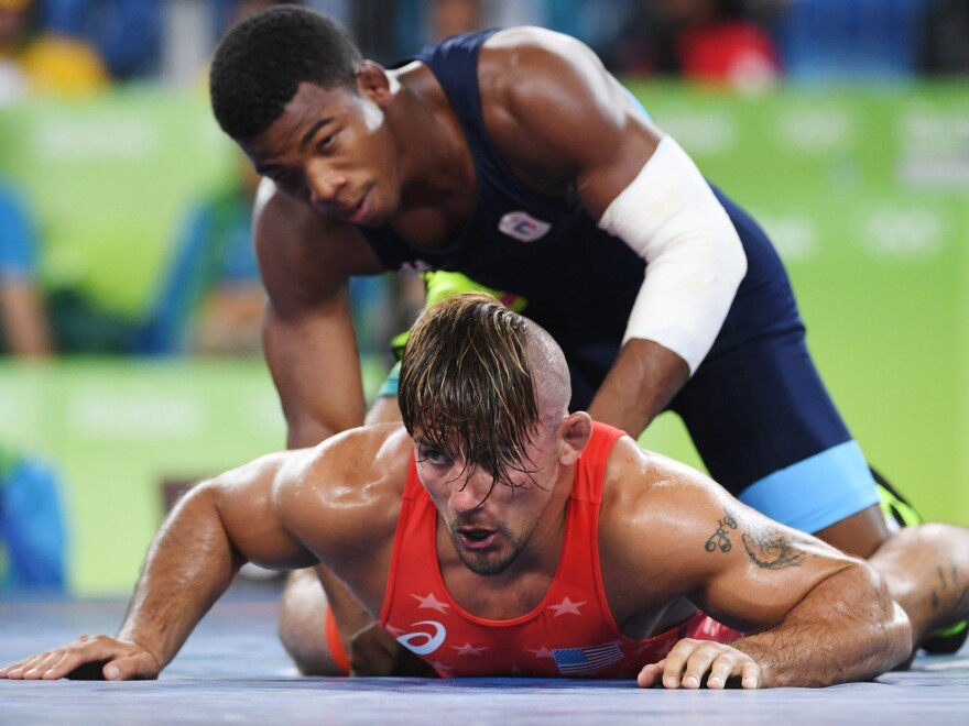 U.S. wrestler Frank Molinaro (red) battles Italy's Frank Chamizo Marquez in the 65-kg (143 pound) bronze medal bout at the 2016 Summer Olympics in Rio de Janiero.  Molinaro, who lost to Marquez, recently retired from the sport when the 2020 Olympics were postponed for a year because of the coronavirus outbreak.