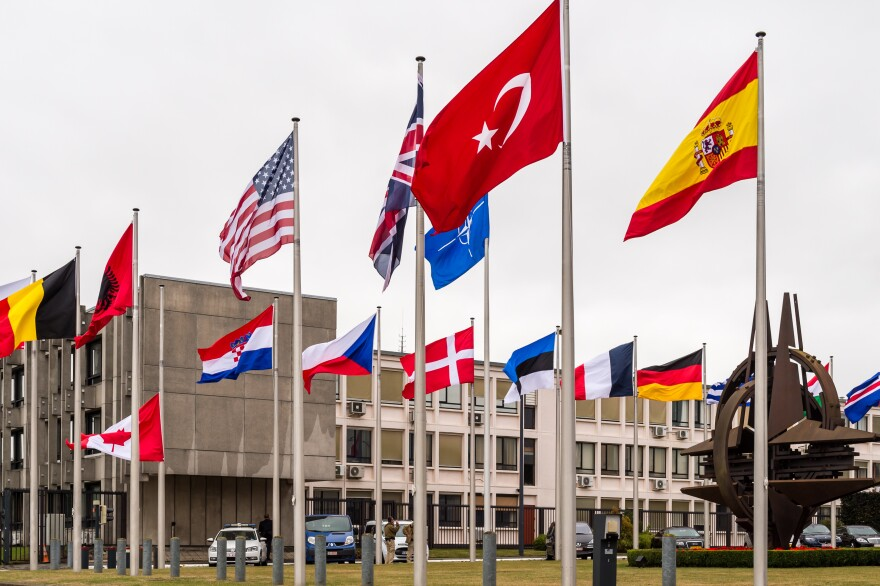 Flags of member nations wave outside NATO headquarters in Brussels. For just the fifth time in its 66-year history, NATO ambassadors met in an emergency, Article 4 session to gauge the threat that the so-called Islamic State poses to Turkey.