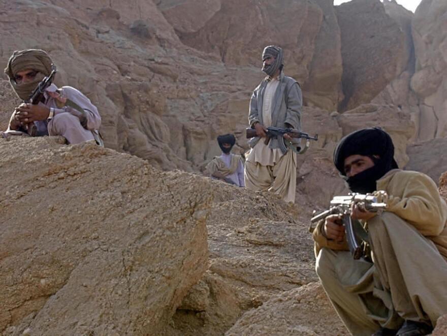 Dera Bugti, Pakistan: tribal guards stand alert. (2006 file photo.)