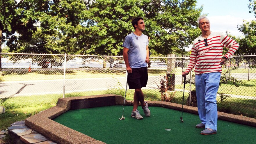 Dylan Dethier and NPR's Scott Simon enjoy a round of putt-putt golf at the East Potomac Golf Course in Washington, D.C.