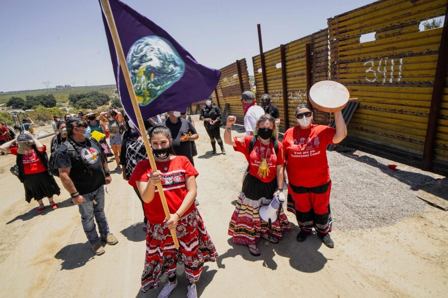 Members of the Kumeyaay band of Indians and demonstrators rally at the United States-Mexico border to protest construction of new wall being constructed on their ancestral grounds on July 1, 2020 in Boulevard, California.(SANDY HUFFAKER/AFP via Getty Images)