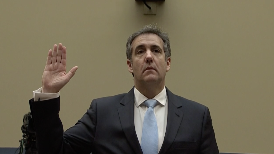 Michael Cohen swears to tell the truth before the House Oversight Committee Wednesday morning.