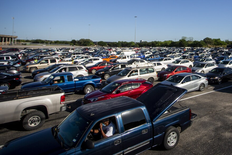 Drivers line up for free food during a Central Texas Food Bank distribution at the Toney Burger Center in South Austin on April 30.
