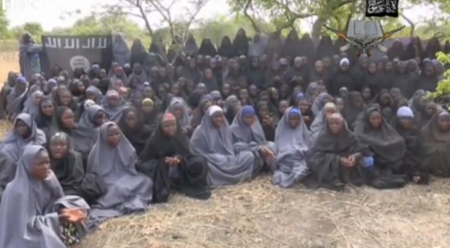 The extremist group Boko Haram kidnapped 267 schoolgirls in Nigeria last year. The group said some of them appear in this still image from a video.